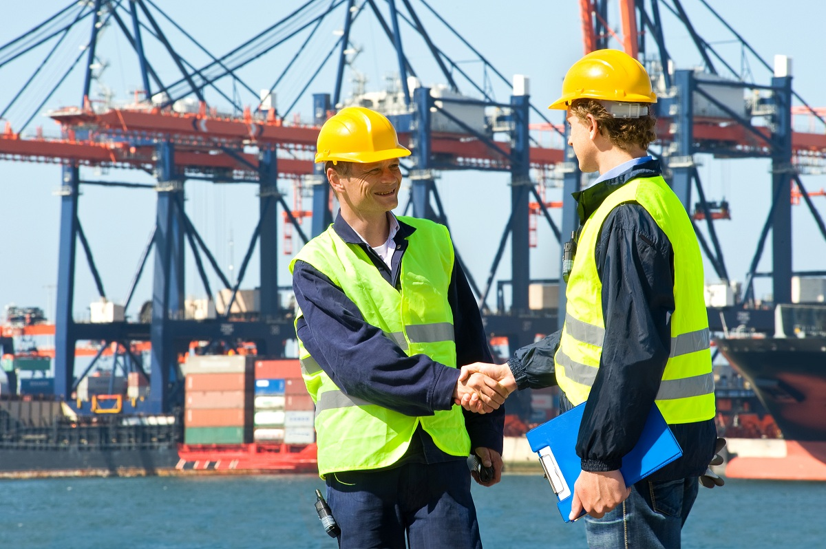 two seafarers shaking hands
